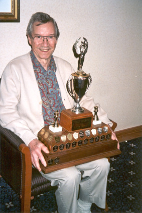 Miervaldis Jursevskis holding the current B.C. Championship Trophy